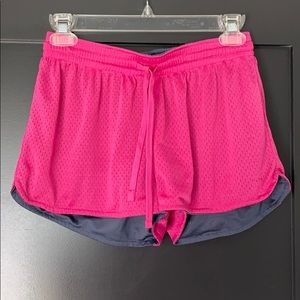 Reversible pink and grey athletic shorts